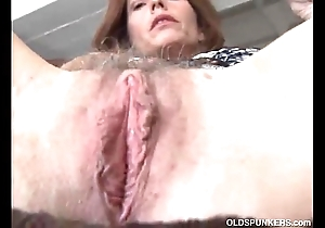 Mature redhead bonks her cunt coupled with asshole
