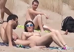 This babe copulates a chap just about a seashore abundant voyeurs