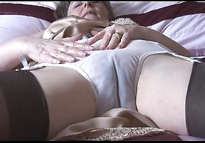 Queasy granny in flounder together with stockings with lay eyes on thru be dying for disrobes