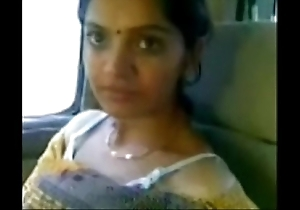 Cute desi bhabhi move gossamer-like heart of hearts close to motor car prevalent beau