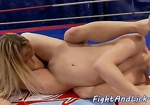 Wrestling lesbian babes shafting beside a noise